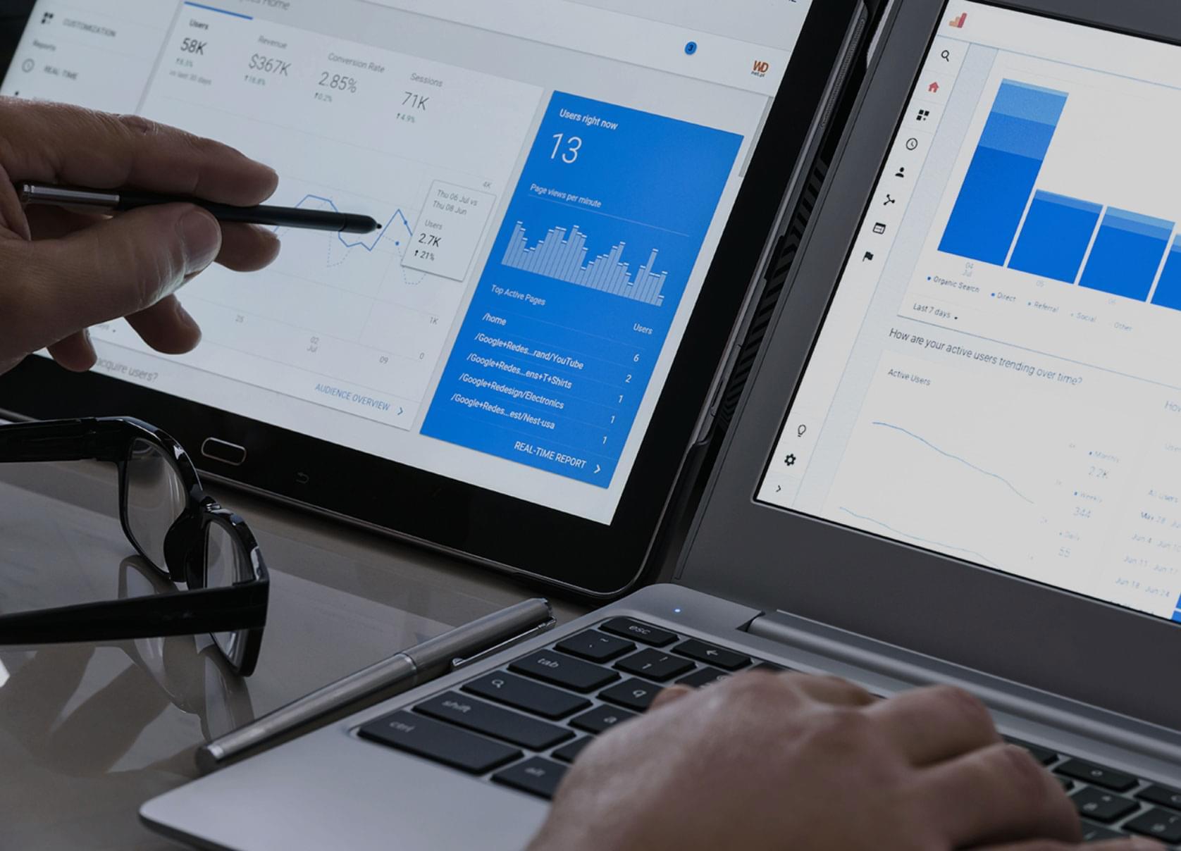 view of 2 laptop screens showing analytics data